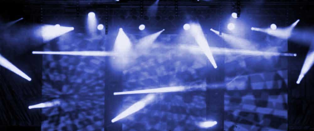 Hintergrundbiuld der TOP40 Band mit viel Scheinwerfern